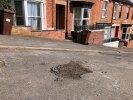 Deep pot hole at the top of Laceby Street